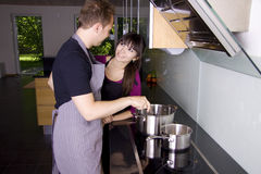 Romantic couple cooking Royalty Free Stock Photos