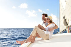 Romantic couple on a cruise sitting on a sailing boat Royalty Free Stock Images