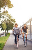 Romantic couple cycling holding hands Stock Photo