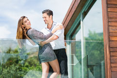 Romantic couple dancing at balcony in resort Stock Images