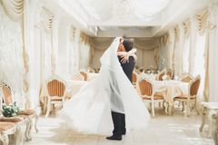 Romantic couple dancing and kissing on their wedding stock photos