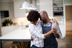 Romantic couple dancing in kitchen Royalty Free Stock Image