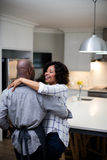 Romantic couple dancing in kitchen Stock Photography
