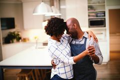 Romantic couple dancing in kitchen. At home royalty free stock image