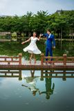 Romantic couple dancing by the lake stock images