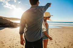 Romantic couple dancing on the shore. Shot of romantic young couple dancing on the beach on a summer day. Young men and women dancing on the seashore Royalty Free Stock Image
