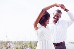 Romantic couple dancing and smiling Stock Photos