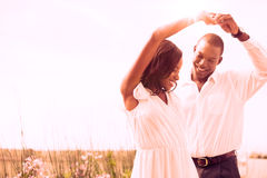 Romantic couple dancing and smiling Royalty Free Stock Images