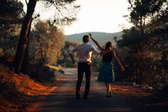 Romantic couple dancing on the street.Having a romantic date.Celebrating anniversary.Valentines day.Birthday date Royalty Free Stock Photos