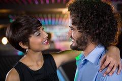 Romantic couple dancing together on dance floor Stock Image