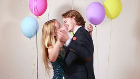Romantic couple dancing. Young romantic couple dancing in photo booth stock footage