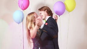 Romantic couple dancing. Young romantic couple dancing in photo booth, graded stock video footage