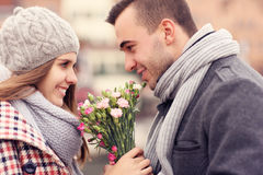 Romantic couple on a date with flowers Royalty Free Stock Images