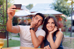 Romantic Couple on a Date at the Restaurant Taking a Selfie Royalty Free Stock Photography