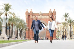 Romantic couple dating having fun in Barcelona. Running laughing outdoors  on date. Young urban