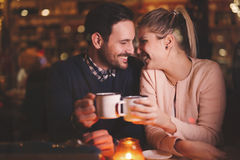 Romantic couple dating in pub. At night Royalty Free Stock Photo