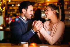 Romantic couple dating in pub at night royalty free stock images