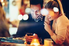 Romantic couple dating in pub at night. Romantic young couple dating in pub at night Royalty Free Stock Images