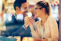 Romantic couple dating in pub at night. Romantic young couple dating in pub at night Stock Photography