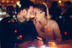 Romantic couple dating in pub at night royalty free stock image