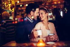 Romantic couple dating in pub at night. Romantic young couple dating in pub at night royalty free stock photography