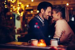Romantic couple dating in pub at night. Romantic young couple dating in pub at night Stock Photo