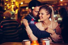Romantic couple dating in pub at night stock image