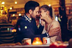 Romantic couple dating in pub at night stock images