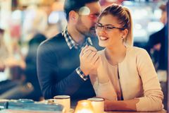 Romantic couple dating in pub at night royalty free stock photography