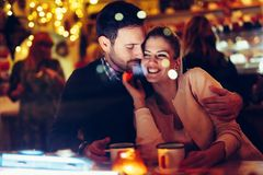 Romantic couple dating in pub at night. Romantic young couple dating in pub at night Royalty Free Stock Image