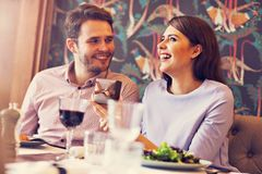 Romantic couple dating in restaurant. Picture showing romantic couple dating in restaurant Royalty Free Stock Photography