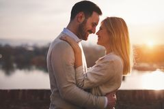 Romantic couple dating in sunset Stock Image