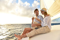 Romantic couple drinking champagne on sailing boat Royalty Free Stock Photos