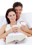 Romantic couple drinking coffee Stock Photos