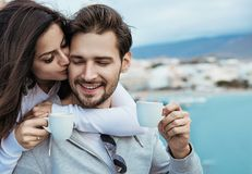 Romantic couple drinking a mornig cup of coffee. Romantic, relaxed couple drinking a mornig cup of coffee royalty free stock photos