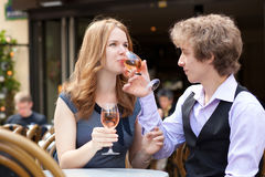 Romantic couple drinking pink wine Royalty Free Stock Images