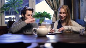 Romantic couple drinking tea at restaurant stock video footage
