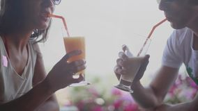 Romantic couple drinking tropical cocktails in an outdoor cafe. 1920x1080. Hd stock video