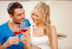 Romantic couple drinking wine Stock Image