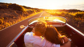 Romantic Couple Driving on Beautiful Road at Sunset Royalty Free Stock Photos