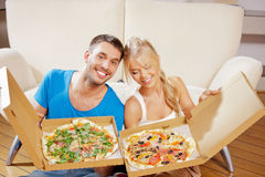Romantic couple eating pizza at home. Picture of happy romantic couple eating pizza at home Royalty Free Stock Photo