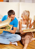 Romantic couple eating pizza at home. Picture of happy romantic couple eating pizza at home Stock Images