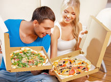 Romantic couple eating pizza at home Stock Photography