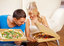 Romantic couple eating pizza at home Royalty Free Stock Photo