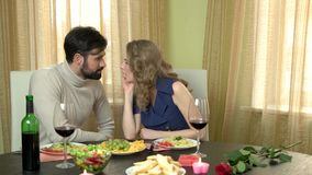Romantic couple eating spaghetti. Beautiful woman and man stock footage