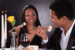 Romantic couple eating sushi Royalty Free Stock Photography