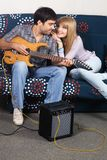 Romantic couple with electric guitar Stock Photo
