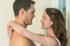 Romantic couple embracing in bathroom Royalty Free Stock Images
