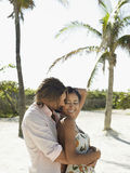Romantic Couple Embracing On Beach Stock Images