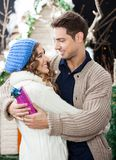 Romantic Couple Embracing At Christmas Store Stock Photos